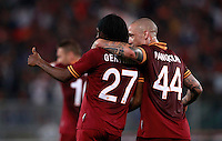 Calcio, Serie A: Roma vs Milan. Roma, stadio Olimpico, 25 aprile 2014.<br /> AS Roma forward Gervinho, of Ivory Coast, center, celebrates with teammate Radja Nainggolan, of Belgium, right, after scoring during the Italian Serie A football match between AS Roma and AC Milan at Rome's Olympic stadium, 25 April 2014.<br /> UPDATE IMAGES PRESS/Isabella Bonotto