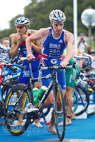 10 APR 2011 - SYDNEY, AUS - Alistair Brownlee exits transition for the start of the bike at the men's ITU World Championship Series triathlon in Sydney, Australia  (PHOTO (C) NIGEL FARROW)