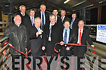RED TAPE: Minister Jimmy Deenihan cuts the tape to officially open the Kenmare Mart extension on Friday, pictured here with James Farrell, Dan McCarthy (manager), Sean McCarthy, Arthur O'Connor, Christie Hussey, Patrick Doyle, JJ O'Sullivan, Patrick Randles, Michael O'Sullivan and Paudie O'Shea.