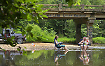 Lisa Hultz, Darryl Barnett and 6 year old Amanda Hultz soak their toes while relaxing in lawn chairs in the Flint River near Walker Lane and Billy Harbin Rd. in Madison County.  Bob Gathany photo.