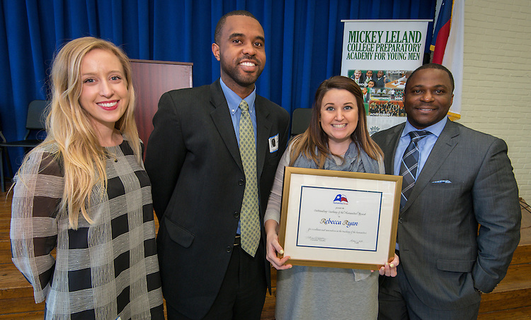 L-R: Sam Moore, Jeremy Brown, Rebecca Ryan and Dameion Crook pose for a photograph after Ryan was presented with a Humanities Texas 2015 Outstanding Teaching of the Humanities Award at Leland College Preparatory Academy for Young Men, February 2, 2016.