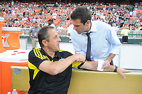 D.C. United head coach Ben Olsen greets Columbus Crew head coach Robert Warzycha.  D.C. United defeated The Columbus Crew 1-0 at RFK Stadium, Saturday August 4, 2012.