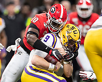 ATLANTA, GA - DECEMBER 7: Malik Herring #10 of the Georgia Bulldogs tackles Joe Burrow #9 of the LSU Tigers during a game between Georgia Bulldogs and LSU Tigers at Mercedes Benz Stadium on December 7, 2019 in Atlanta, Georgia.