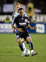 21 March 2009: Ramiro Corrales of Earthquakes dribbles the ball away from Revolution defender during the game at Buck Shaw Stadium in Santa Clara, California. New England Revolution defeated Earthquakes, 1-0.