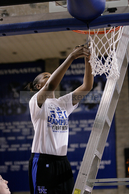 Sophomore DeNesha Stallworth cuts down a piece of the net during the Kentucky Women's celebration of winning the SEC regular season championship 2/26/12 at Memorial Coliseum in Lexington, Ky. Photo by Quianna Lige | Staff