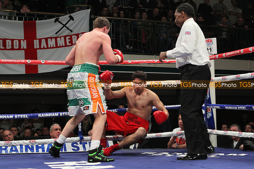 Gary Corcoran (green/white) shorts defeats Faheem Khan in a Light-Middleweight Boxing Contest at York Hall, Bethnal Green, London, promoted by Frank Warren - 22/02/14 - MANDATORY CREDIT: Gavin Ellis/TGSPHOTO - Self billing applies where appropriate - 0845 094 6026 - contact@tgsphoto.co.uk - NO UNPAID USE
