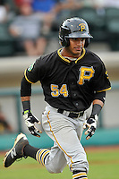 Center fielder Michael De La Cruz (54) of the Bristol Pirates runs out a ground ball in a game against the Pulaski Yankees on Tuesday, July 5, 2016, at Calfee Park in Pulaski, Virginia. Pulaski won, 6-3. (Tom Priddy/Four Seam Images)