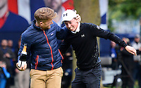 Matthew Fitzpatrick of England celebrates on the 18th green with members of his ISM Management team following his victory during Round 4 of the 2015 British Masters at the Marquess Course, Woburn, in Bedfordshire, England on 11/10/15.<br /> Picture: Richard Martin-Roberts | Golffile