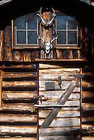 Skulls of whitetail deer hang over the door of an old cabin on Bear Island in Apostle Islands National Lakeshore near Bayfield, Wis.