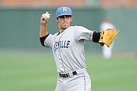 Shortstop Alec Mehrten (7) of the Asheville Tourists warms up before a game against the Greenville Drive on Sunday, July 20, 2014, at Fluor Field at the West End in Greenville, South Carolina. Asheville won game two of a doubleheader, 3-2. (Tom Priddy/Four Seam Images)