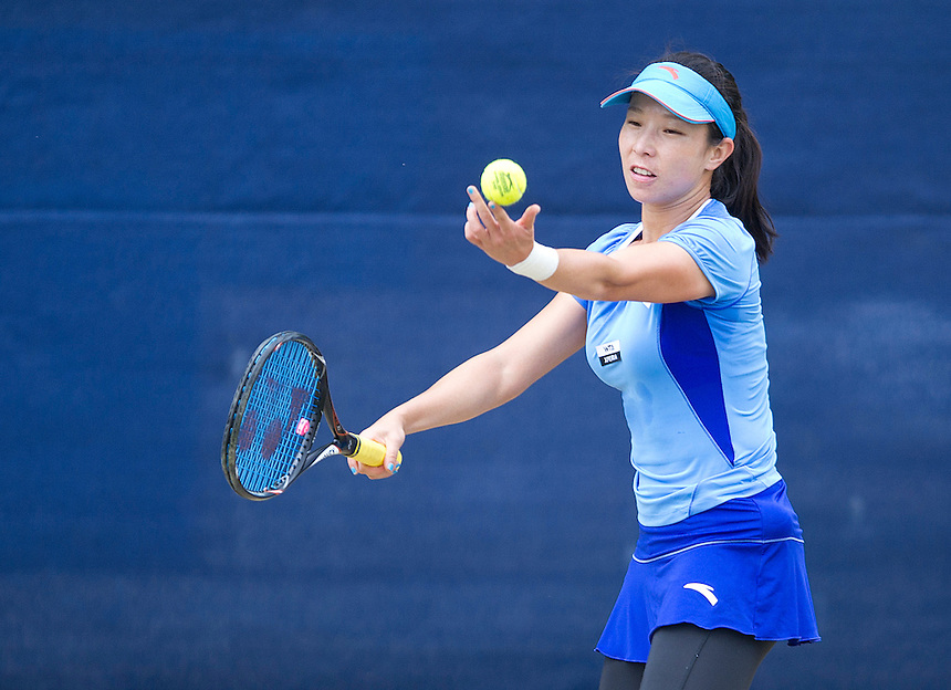 Jie Zheng CHN in action during her victory over Lesia Tsurenko UKR in their Women's Singles 1st Round match - J.Zheng (CHN) def. A.Kudryavtseva (RUS) 6-4 4-6 6-3..International Womens Tennis - 2012 WTA Tour - The AEGON Classic - Edgbaston Priory Club - Birmingham - Day 2 - Tuesday 7th June 2012..