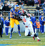 SIOUX FALLS, SD - NOVEMBER 7:  Brandon Andrews #3 from South Dakota State University makes a catch past Davontae Harris #10 from Illinois State en route to a touchdown in the second half Saturday in the final game at Coughlin Alumni Stadium in Brookings. (Photo by Dave Eggen/Inertia)