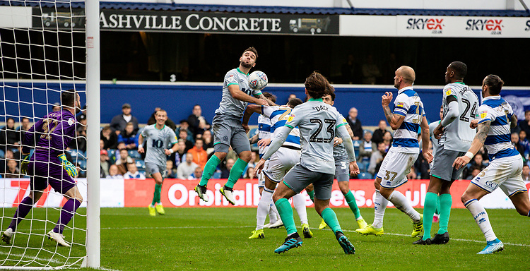 Blackburn Rovers' Adam Armstrong (centre) competing in the air <br /> <br /> Photographer Andrew Kearns/CameraSport<br /> <br /> The EFL Sky Bet Championship - Queens Park Rangers v Blackburn Rovers - Saturday 5th October 2019 - Loftus Road - London<br /> <br /> World Copyright © 2019 CameraSport. All rights reserved. 43 Linden Ave. Countesthorpe. Leicester. England. LE8 5PG - Tel: +44 (0) 116 277 4147 - admin@camerasport.com - www.camerasport.com