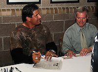 Former major leaguer Jose Canseco signs autographs for fans in the concourse during a game between the Rochester Red Wings and Lehigh Valley IronPigs at Frontier Field on August 18, 2011 in Rochester, New York.  Lehigh Valley defeated Rochester 11-1.  (Mike Janes/Four Seam Images)