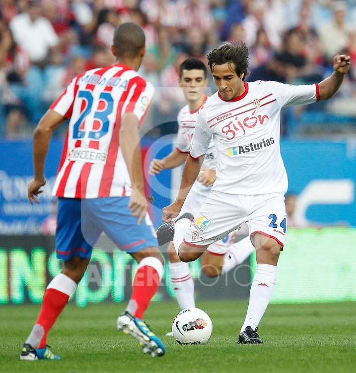 Atletico de Madrid's Miranda and Sporting de Gijon's Trejo during la Liga match on september 21st, 2011..Photo: Cesar Cebolla / ALFAQUI