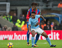Raheem Sterling of Manchester City holds off Wilfried Zaha of Crystal Palace during the Premier League match between Crystal Palace and Manchester City at Selhurst Park, London, England on 31 December 2017. Photo by Andy Rowland.