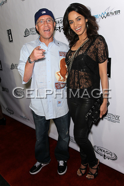 CRAIG NOBLES, MALLIKA SHERAWAT. Attendees to Souljah Boy Red Carpet Birthday Bash and Performance, sponsored by Swaggmedia.com, at the Highlands. Hollywood, CA, USA. July 28, 2010.