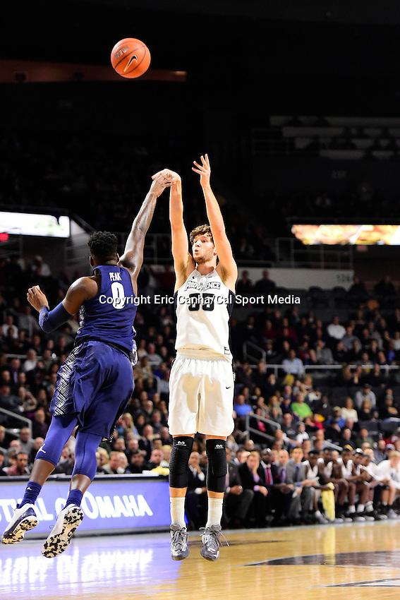 Wednesday, January 4, 2016: Providence Friars guard Ryan Fazekas (35) shoots with pressure from Georgetown Hoyas guard L.J. Peak (0) during the NCAA basketball game between the Georgetown Hoyas and the Providence Friars held at the Dunkin Donuts Center, in Providence, Rhode Island. Providence defeats Georgetown 76-70 in regulation time. Eric Canha/CSM