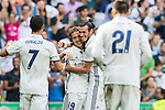 Luka Modric of Real Madrid celebrates with teammates Gareth Bale and Cristiano Ronaldo during the La Liga match between Real Madrid and Osasuna at the Santiago Bernabeu Stadium on 10 September 2016 in Madrid, Spain. Photo by Diego Gonzalez Souto / Power Sport Images