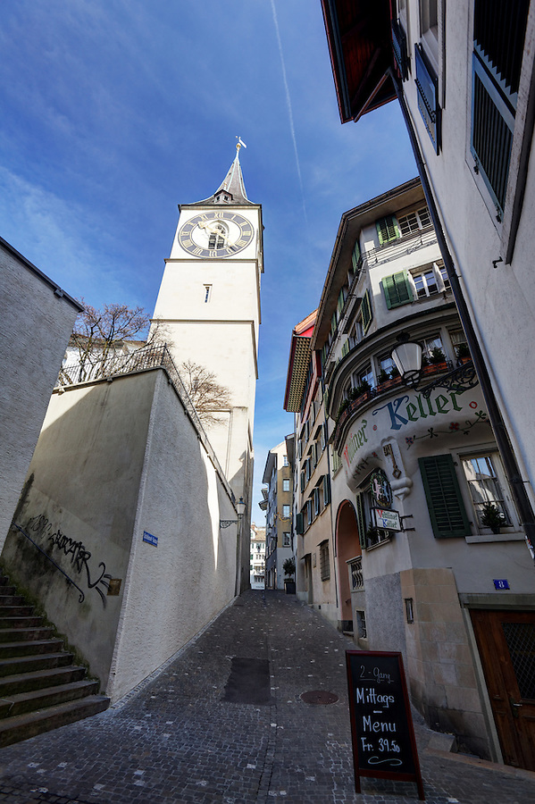 St. Peter church tower and cobblestone streets, old town of Zürich, Switzerland