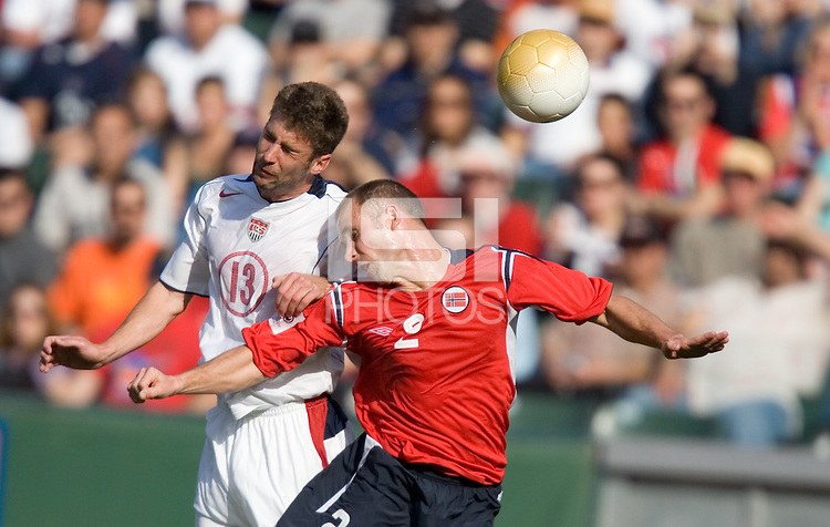 USA's Pat Noonan heads the ball toward the goal over Norway's Steinar Pedersen during an international friendly, in Carson, California, Sunday, Jan. 29th, 2006.