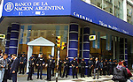 Argentinean Federal Policemen stand guard outside the Argentinean Nation Bank in downtown Buenos Aires, April 23, 2003, as demonstrators protest against the economic policy which took their savings since the big economic crisis in January 2001. With just a few days for the up coming general elections demonstrations take place against the political and economic policies every day in Buenos Aires.Photo by Quique Kierszenbaum