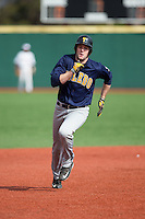 Jordan Kesson (24) of the Toledo Rockets legs out a triple against the Virginia Tech Hokies at The Ripken Experience on February 28, 2015 in Myrtle Beach, South Carolina.  The Hokies defeated the Rockets 1-0 in 10 innings.  (Brian Westerholt/Four Seam Images)