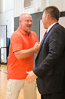 NWA Democrat-Gazette/CHARLIE KAIJO Hon. Thomas Smith (from right) congratulates Adult Drug Court graduate Jackson Taylor during the Adult Drug Court and Veterans Treatment Court graduation, Friday, June 8, 2018 at the Church of Christ in Bentonville. <br /><br />Some participants in Benton County&acirc;&euro;&trade;s drug and veterans court graduated from the program, their largest class. A ceremony was held Friday and Lt. Governor Tim Griffith was the guest speaker.