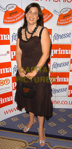 KIRSTY ALLSOP.At The Prima High Street Fashion Awards,.London, 13th September 2005.full length black brown velvet dress silver strappy sandals purse handbag butterfly big bead necklace.Ref: CAN.www.capitalpictures.com.sales@capitalpictures.com.©Capital Pictures