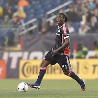 New England Revolution midfielder Shalrie Joseph (21) passes the ball. In a Major League Soccer (MLS) match, the New England Revolution defeated Chicago Fire, 2-0, at Gillette Stadium on June 2, 2012.