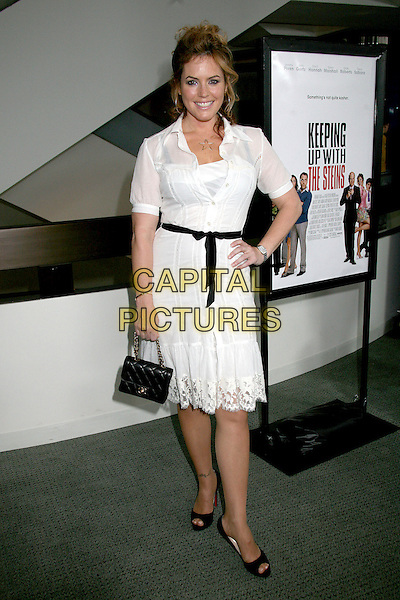 """SANDRA TAYLOR.Los Angeles Premiere of """"Keeping Up With The Steins"""", West Hollywood, California, USA..May 8th, 2006.Photo: Byron Purvis/AdMedia/Capital Pictures.Ref: BP/ADM.full length white dress hand on hip black purse belt.www.capitalpictures.com.sales@capitalpictures.com.© Capital Pictures."""