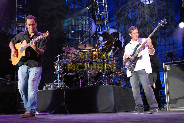 Dave Matthews, Carter Beauford and Stefan Lessard.The Dave Matthews Band performs live at Walnut Creek Amphitheater, Raleigh, North Carolina, USA, 18 September 2007..full length music concert gig on stage  guitar.CAP/ADM/MO.©Moose/AdMedia/Capital Pictures.