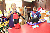 Children from the Creative Mansion Children&rsquo;s Academy located at 4745 S. Ellis showed off their re-inventions of various products that we use every day Friday afternoon.<br /> <br /> 1271 &ndash; Ajani Dosunmu shows off his fire extinguisher while Adedamola Oshuntyi watches.