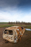 Burnt out van abandoned on farmland <br /> &copy;Tim Scrivener Photographer 07850 303986<br />      ....Covering Agriculture In The UK....