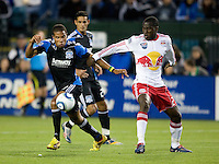Ryan Johnson of the Earthquakes dribbles the ball away from Tony Tchani of Red Bulls during the game at Buck Shaw Stadium in Santa Clara, California.  San Jose Earthquakes defeated New York Red Bulls, 4-0.
