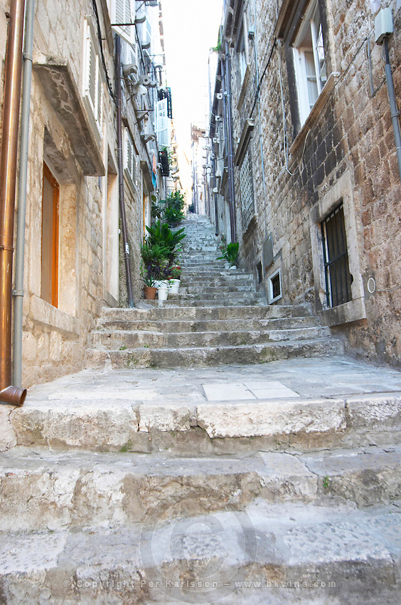 View from the Prijeko street up a narrow street with steep stairs. Narrow cobble stone street. Dubrovnik, old city. Dalmatian Coast, Croatia, Europe.