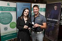 Denada Berisha of Remus Uomo gives a raffle prize to Rob Sharman