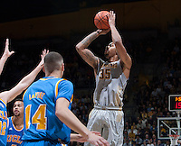Richard Solomon of California shoots the ball during the game against UCLA at Haas Pavilion in Berkeley, California on February 19th, 2014.  UCLA defeated California, 86-66.
