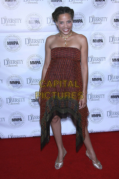 TAWNEY CYPRESS.2006 Diversity Awards - Arrivals held at CAWAury Plaza Hotel, CAWAury City, California, USA,.20 November 2006.full length gold necklace strapless brown dress.CAP/ADM/ZL.©Zach Lipp/AdMedia/Capital Pictures.
