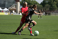 Allie Long (left) and Tina DiMartino (right). Washington Freedom defeated FC Gold Pride 4-3 at Buck Shaw Stadium in Santa Clara, California on April 26, 2009.