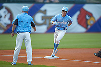 Brian Miller (5) of the North Carolina Tar Heels rounds third base against the North Carolina State Wolfpack in Game Twelve of the 2017 ACC Baseball Championship at Louisville Slugger Field on May 26, 2017 in Louisville, Kentucky. The Tar Heels defeated the Wolfpack 12-4. (Brian Westerholt/Four Seam Images)