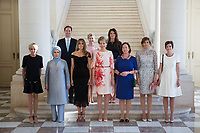 Photo de famille des conjoints des chefs d&rsquo;Etat et de gouvernement sur les marches de l&rsquo;escalier aux lions du Ch&acirc;teau Royal de Laeken; ( De gauche &agrave; droite ) Brigitte Macron ( France ), Emine Gulbaran Erdogan, ( Turquie ), Melania Trump ( USA ),  Reine Mathilde de Belgique, Ingrid Schulerud ( OTAN ), Desislava Radeva ( Bulgarie ), Amelie Derbaudrenghien ( Belgique ),  Gauthier Destenay ( Luxembourg ), Madame Stropnik ( Slovenie ), Madame Baldvinsdottir ( Islande ).<br /> Belgique, Bruxelles, 25 mai 2017.<br /> The First Ladies attend a dinner at the Belgian Royal Castle(front row L-R) First Lady of France Brigitte Macron, First Lady of Turkey Emine Gulbaran Erdogan, First Lady of the US Melania Trump, Queen Mathilde of Belgium, Stoltenberg's partner Ingrid Schulerud, Partner of Bulgaria's President Desislava Radeva, partner of Belgian Prime Minister Charles Michel, Amelie Derbaudrenghien, First Gentleman of Luxembourg Gauthier Destenay, Partner of the Slovenia Prime Minister Mojca  Ms Stropnik, Ms Baldvinsdottir  ( Iceland )<br /> Belgium, Brussels, 25 May 2017