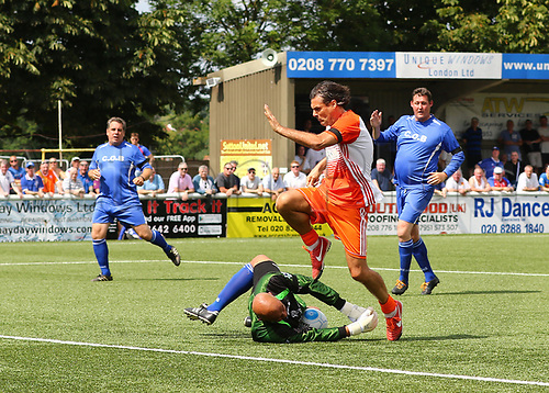 June 17th 2017, Gander Green Lane, Sutton, England; Football Charity Match; Chelsea Legends versus Rangers Legends; Chelsea Keeper Tony Warner dives at the feet and gathers the ball from Rangers Marco Negri