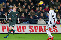 Kevin De Bruyne of Manchester City prepares to control the ball under pressure from Martin Olsson of Swansea City during the EPL - Premier League match between Swansea City and Manchester City at the Liberty Stadium, Swansea, Wales on 13 December 2017. Photo by Mark  Hawkins / PRiME Media Images.