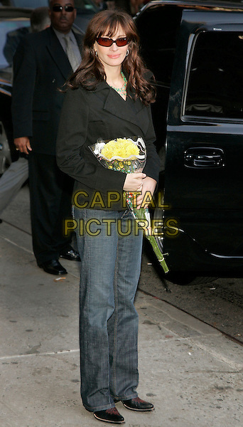 JULIA ROBERTS.Departs the David Letterman show at Ed Sullivan Theatre, New York, NY, USA. .May 4th, 2006.Photo: Jackson Lee/Admedia/Capital Pictures.Ref: JL/ADM.full length flowers bouquet jeans denim black jacket sunglasses shades .www.capitalpictures.com.sales@capitalpictures.com.© Capital Pictures.