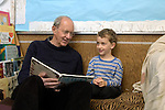 "Berkeley CA Grandpa reading to grandson, four-years-old during ""Grandparents"" Day"" at preschool  MR"