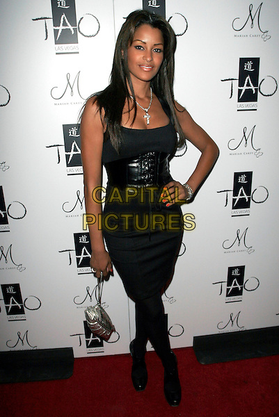 CLAUDIA JORDAN.At New Year's Eve Party at TAO Nightclub at The Venetian Hotel Casino,  Las Vegas, Nevada, USA, 31 December 2007..full length black dress hand on hip.CAP/ADM/MJT.©AdMedia/Capital Pictures.