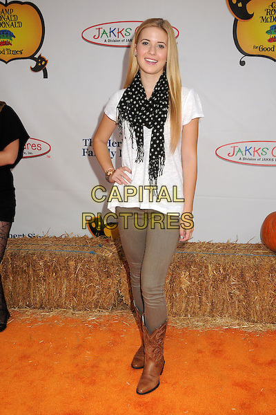Caroline Sunshine.20th Annual Camp Ronald McDonald Halloween Carnival held at the Universal Studios Backlot, Universal City, California, USA..October 21st, 2012.full length white top black scarf beige trousers hand on hip brown boots .CAP/ADM/BP.©Byron Purvis/AdMedia/Capital Pictures.
