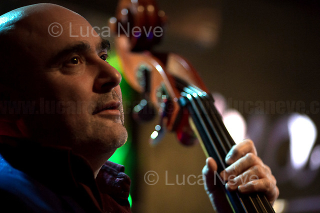 Rome, 01/02/2018. Alessandro Nosenzo, and his Band, in concert at 'Na Cosetta, Pigneto, Rome. From Nosenzo Official page: &lt;&lt;Mediterranean Sound and Gypsy Heart, Alessandro Nosenzo embraces different styles and historical periods for his music, looks to the East and embraces the earth. His music is a mixture of cultures and gives way to dances watching the world as a beautiful playground [&hellip;]&gt;&gt;. <br /> <br /> The Band is composed of: <br /> Alessandro Nosenzo (Lead singer, songwriter, guitar); <br /> Giulia Anita Bari (Violin); <br /> Sergio Di Leo (Saxophone); <br /> Renato Gattone (Contrabass / Double Bass - https://www.renatogattone.net/). <br /> <br /> For more information about the band &amp; to listen Nosenzo's music please click here: https://www.facebook.com/nosenzoufficiale/ &amp; https://www.facebook.com/events/161481401242625/ &amp; https://www.youtube.com/watch?v=uPBa5PEKt4k &amp; https://soundcloud.com/alessandro-nosenzo &amp; https://www.youtube.com/channel/UCDstp8G0DpvFJkryOqL5xDQ &amp;  https://twitter.com/iovengodalsud<br />   <br /> For more information about the venue please click here: http://www.nacosetta.com/ &amp; https://www.facebook.com/nacosetta/