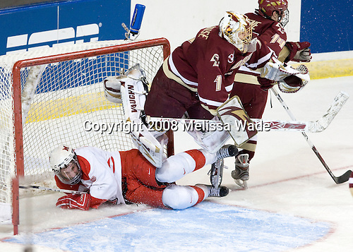 Brian Kaufman (Miami - 15), John Muse (BC - 1), Matt Greene (BC - 14) - The Boston College Eagles defeated the Miami University Redhawks 4-3 in overtime on Sunday, March 30, 2008 in the NCAA Northeast Regional Final at the DCU Center in Worcester, Massachusetts.